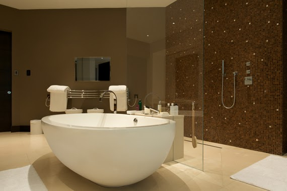 mosaic bathroom with free standing bathtub