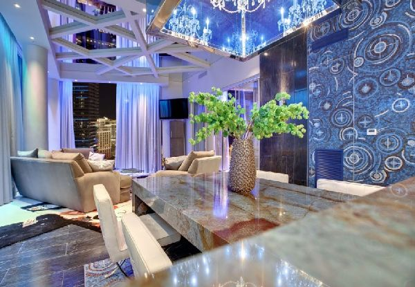 stone dining table idea in amazing penthouse interior by Mark Tracy