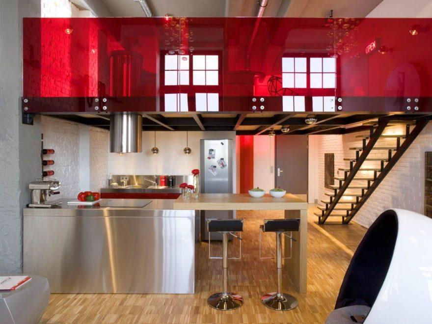 modern inox kitchen with island and red plexiglass