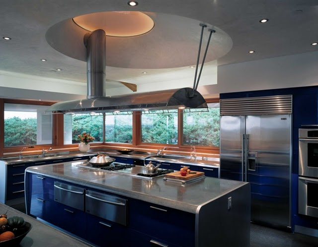 modern blue and inox kitchen with island and many windows