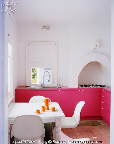 modern traditional pink kitchen with oven