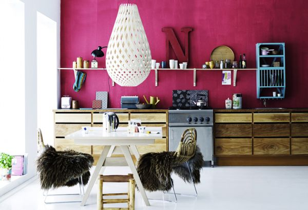 traditional wood kitchen with fuchsia wall and shelves