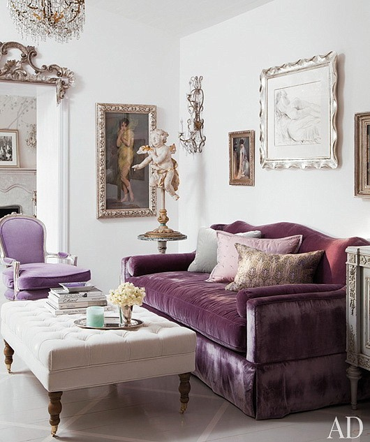 purple small living room with velvet sofa