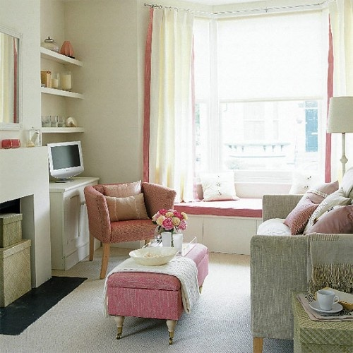 white and pink small living room with fireplace