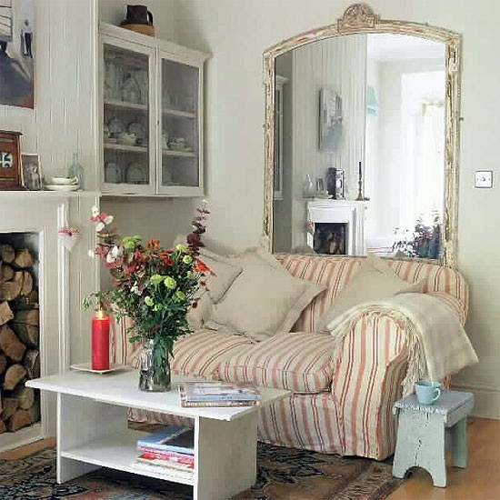 Small living room with fireplace and large mirror