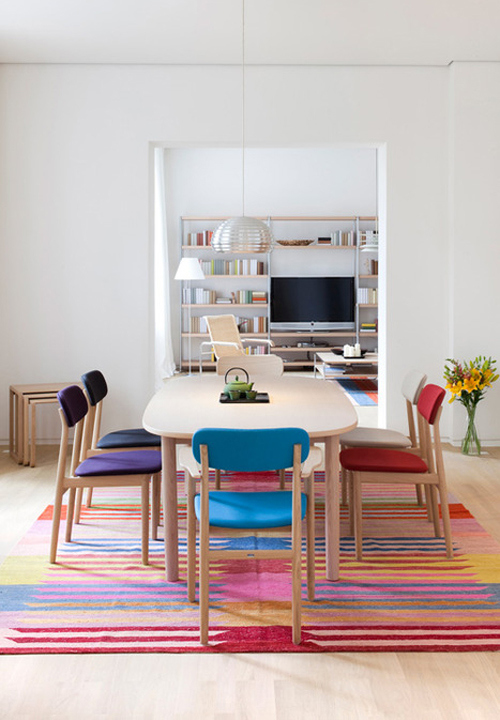 Colorful Dining Room with Multicolored Chairs 4
