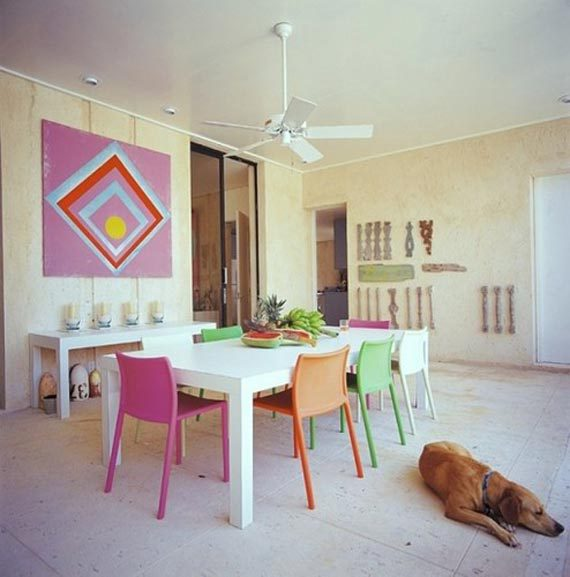 colorful dining room with multicolored chairs 5