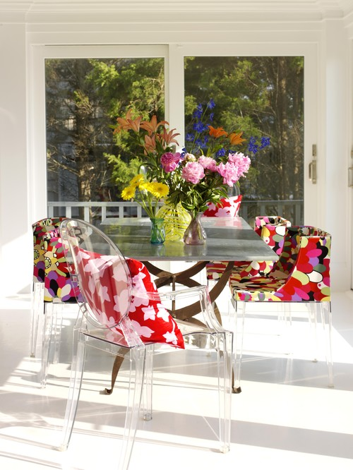 Colorful Dining Room with Multicolored Chairs 8
