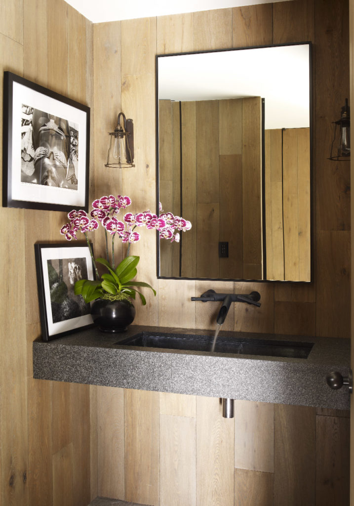 wood powder room with black vanity