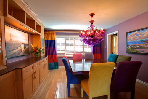 Colorful Dining Room with Multicolored Chairs 11