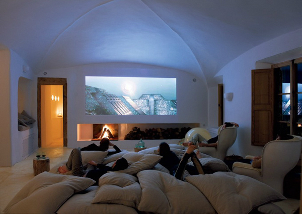 dining room home theatre with big pillows Cave House in Majorca