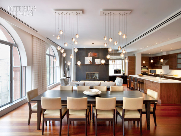 modern_dining_room_with_chairs_by_jeff_behnke_and_roland_zehetbauer_surround_a_custom_walnut_dining_table_photo_by_eric_laignel_