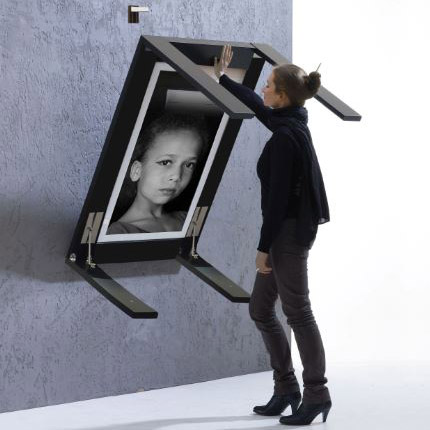 IvyDesign wall-folding-tables turn into a picture frame when they are not in use 2
