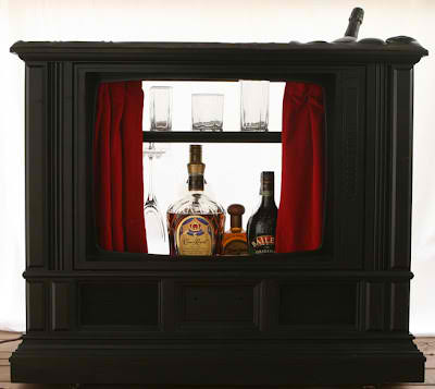 old cabinet tv recycled into a cocktail bar
