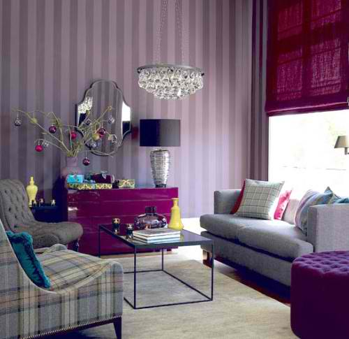 living room with purple console and stripe wallpaper