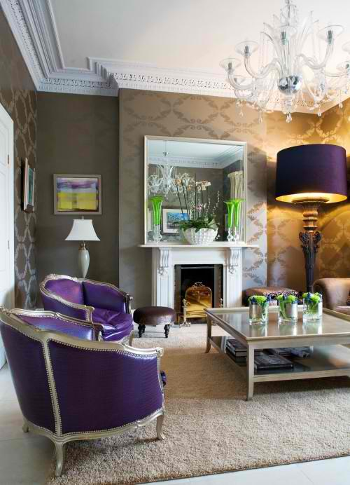 living room design with gold wallpaper purple armchairs and floor lighting