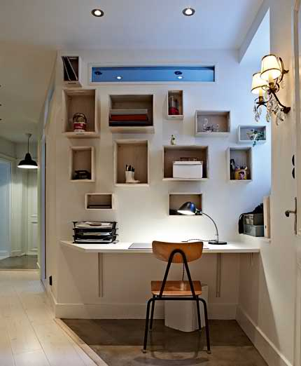 small home office with wall shelves