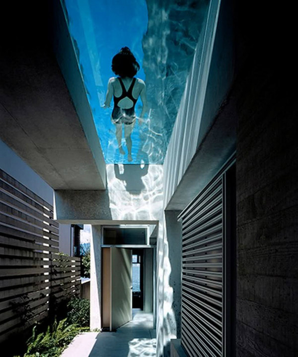 house with cool swimming pool feature above main entrance 7