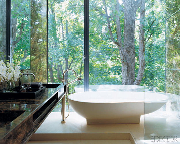 bathroom with forest view by Yabu Pushelberg