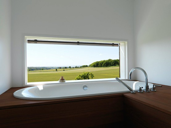 wooden bathroom with garden view