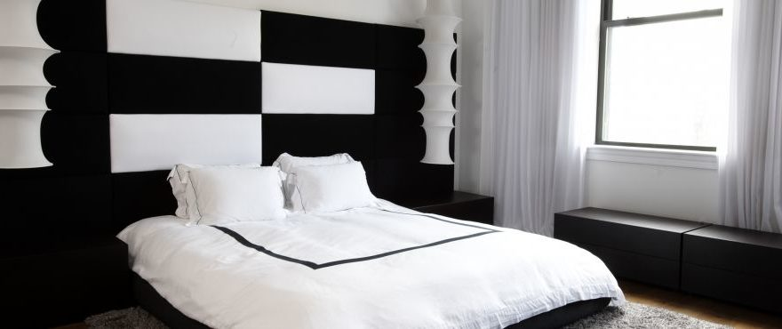 modern black and white bedroom by holzman interiors