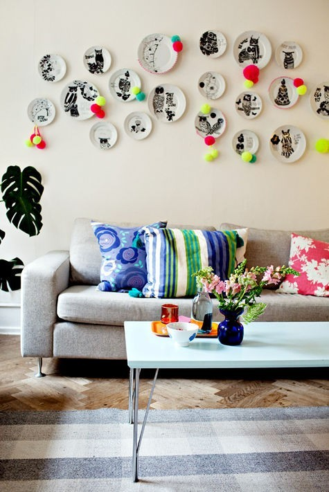 colorful living room with plates on the wall