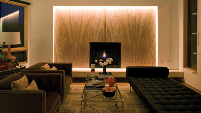 contemporary living room with fireplace by cantilever design
