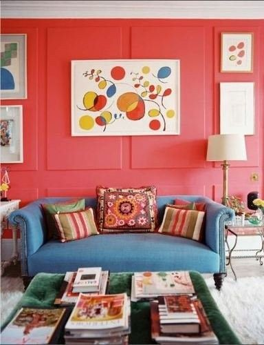 red wall and a blue sofa