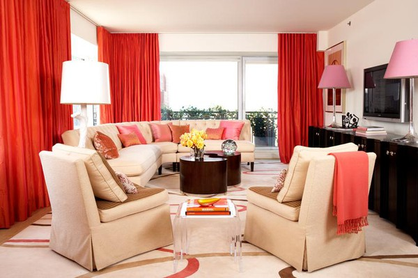 beige sofas and red curtains