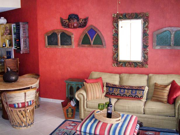 beige couches and red walls