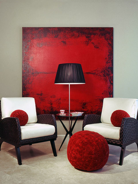 white armchairs and red painting