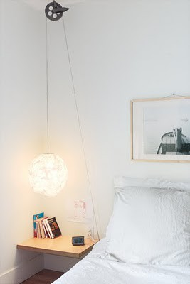 Bedside pendant hanging from clothesline pulley