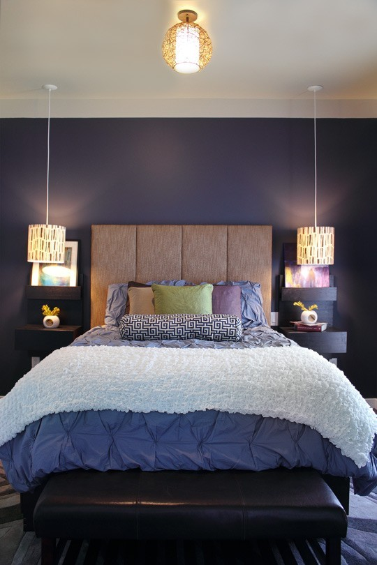 purple bedroom with hanging lights