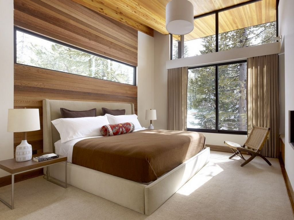 Modern master bedroom with mountain view in the sugar bowl residence