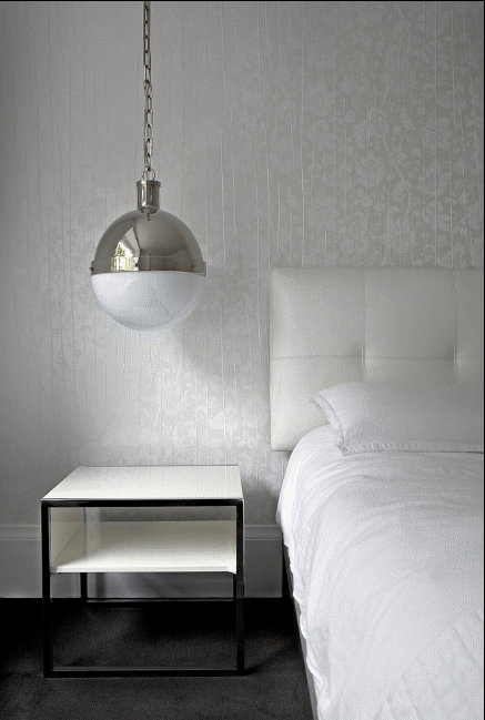 white bedroom with hanging lights