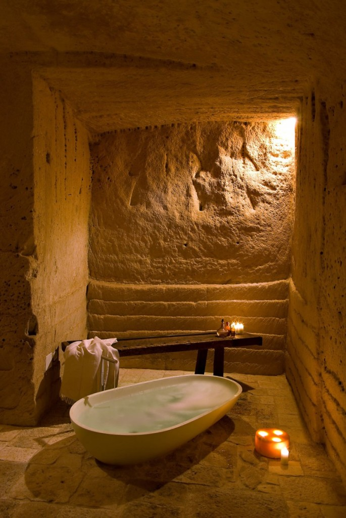 hotel into limestone caves in Italy 12