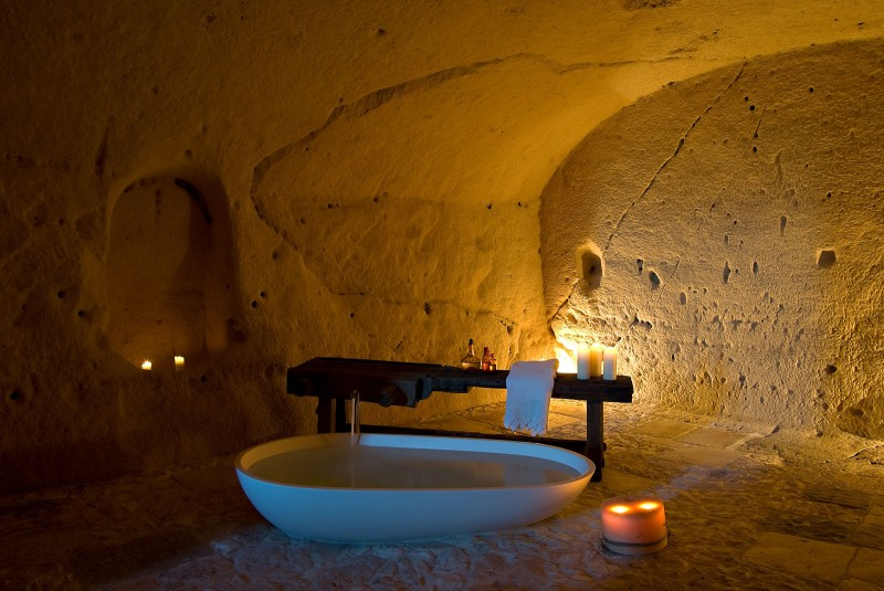 hotel into limestone caves in italy 13