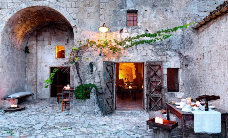 hotel into limestone caves in italy 15