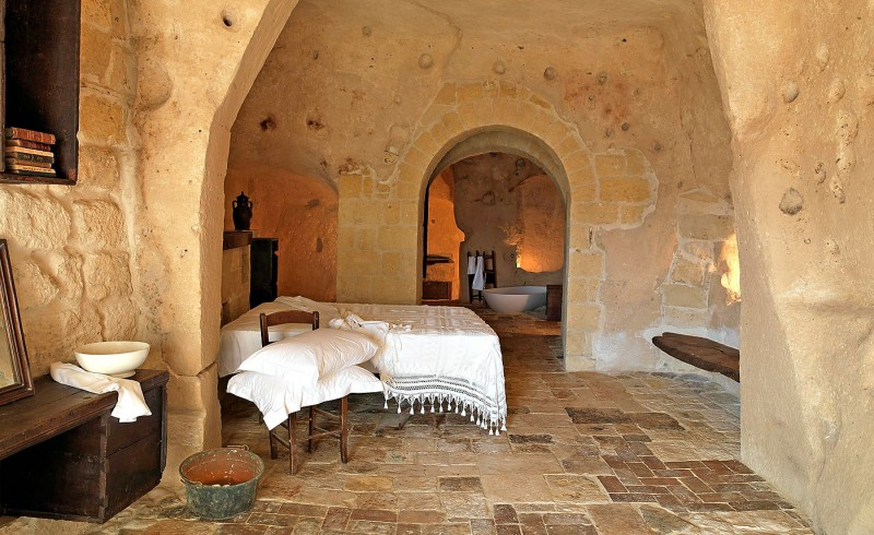 hotel into limestone caves in italy 5