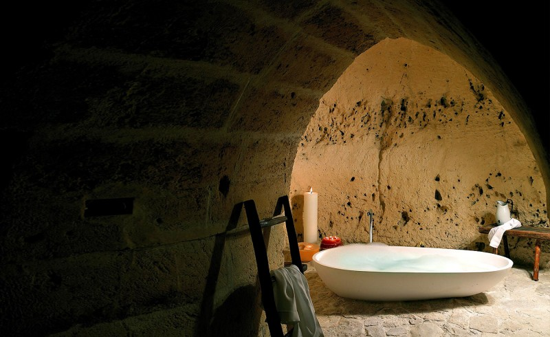 hotel into limestone caves in italy 8