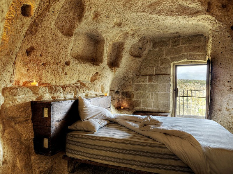 hotel into limestone caves in italy 9