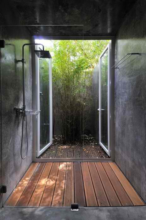 concrete vathroom shower with teak floor
