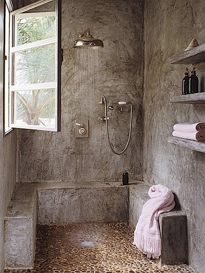 bathroom with concrete walls and raw floor