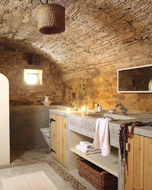 concrete batrhroom with raw stone and wood