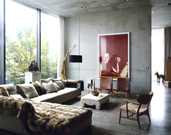 beautiful boar formed concrete fireplace and exposed wood ceiling