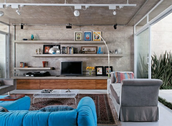 concrete living room and shelves
