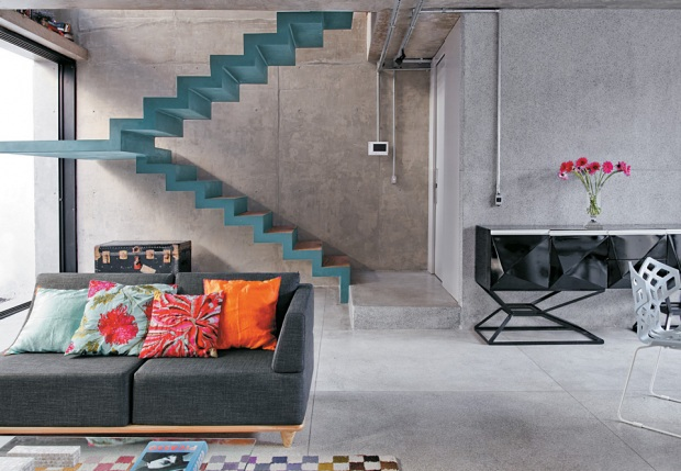 concrete living room with colored stairs