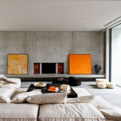 concrete living room and fireplace