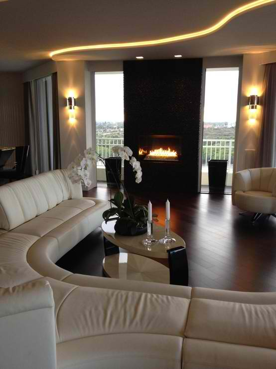 contemporary living room design with white sofa and black fireplace