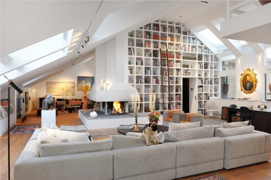 contemporary living room with amazing library and fireplace
